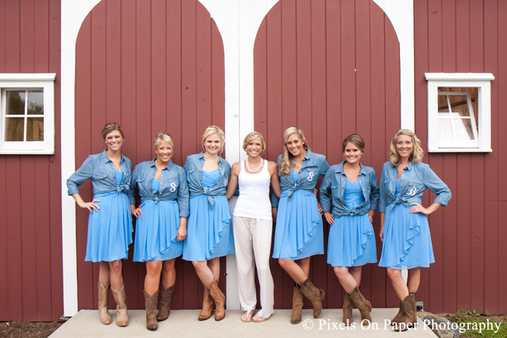 Bride and bridesmaids denim and boots at outdoor country mountain wedding at big red barn in west jefferson nc photo