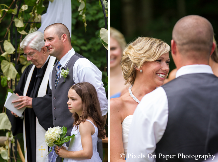 Bride and groom wedding ceremony vows at outdoor country mountain wedding at big red barn in west jefferson nc photo