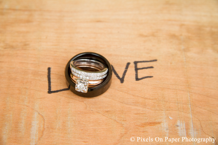 Bride and groom wedding rings at outdoor country mountain wedding at big red barn in west jefferson nc photo