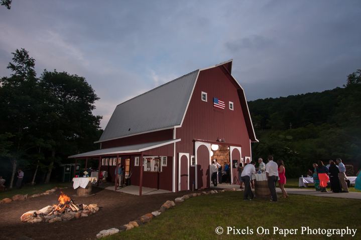 Night photo of barn and fire pit at outdoor country mountain wedding at big red barn in west jefferson nc photo