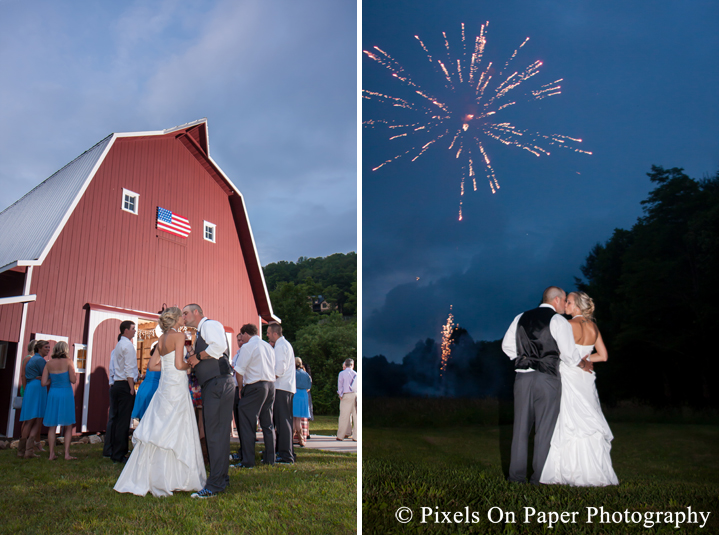Bride and groom fireworks at outdoor country mountain wedding at big red barn in west jefferson nc photo