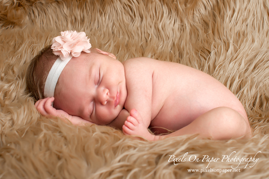 Newborn Baby Portrait. Baby comfy pose during her portrait session with Pixels On Paper Photo