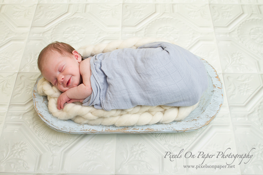 Newborn baby photographer. Holden sleeping during photo session with Pixels On Paper Photography