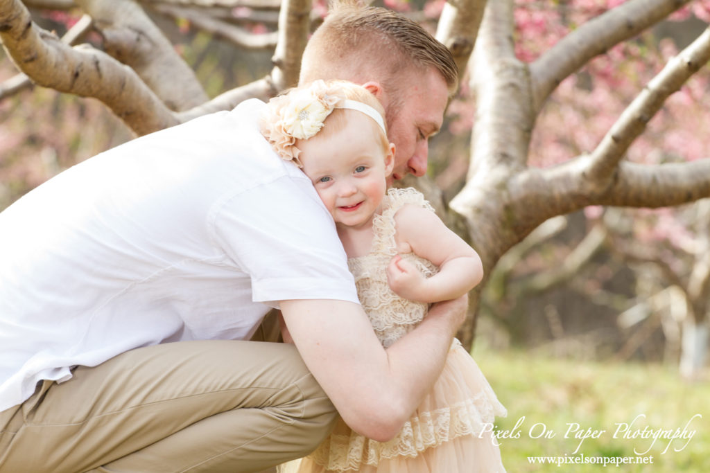Arnold family outdoor spring peach orchard photos by Pixels On Paper Portrait Photographers photo
