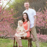 Arnold family outdoor spring peach orchard photos by Pixels On Paper Portrait Photographers photos